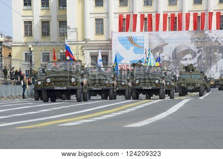 ST. PETERSBURG, RUSSIA - MAY 05, 2015: The Banner Group on cars UAZ-469 at a rehearsal of the Victory Parade