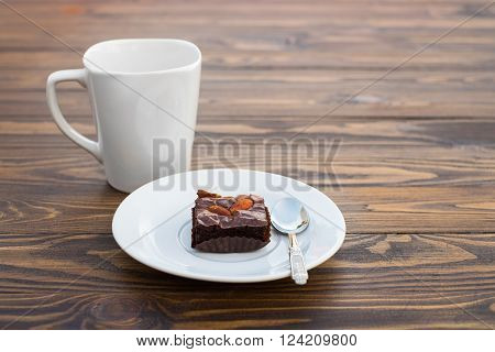 Homemade Chocolate Brownie With Almond And A White Mug Cup