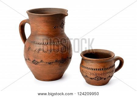 clay jug and a mug isolated on white background