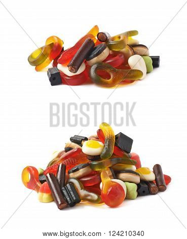 Pile of multiple colorful gelatin and licorice based candies isolated over the white background, set of two different foreshortenings