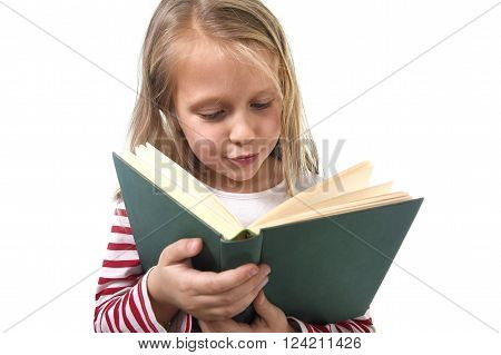 young sweet little 6 or 7 years old with blond hair girl reading a book looking curious and fascinated in child education and school concept isolated on white background