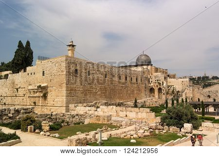 Jerusalem, Israel - May 8, 2013: Dome of Al-Musalla Al-Qibli Al-Aqsa - the largest mosque in the city, Archaeological Gardens of Umayyad Palaces and Mount of Olives. Tourists sightseeing.