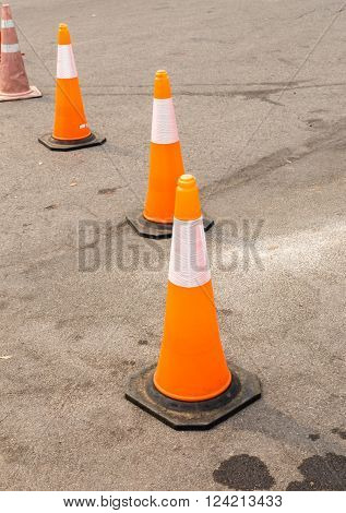 traffic cone on the street, warning sign