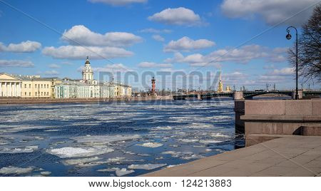 University Embankment St. Petersburg during spring break-up. A view of the cabinet of curiosities, rostral column, Peter and Paul Fortress.