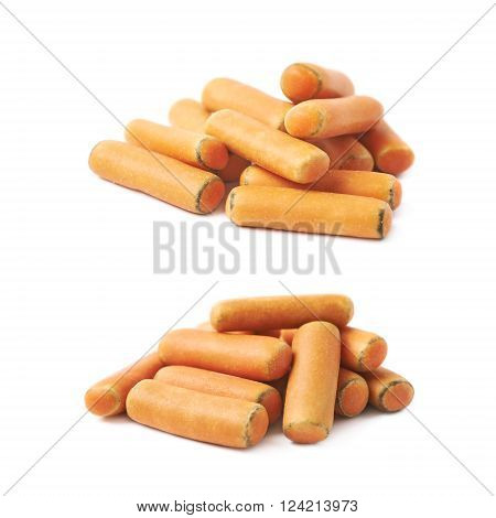 Pile of orange glaze licorice stick candy isolated over the white background, set of two different foreshortenings
