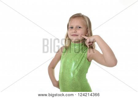 6 or 7 years old little girl with blond hair and blue eyes smiling happy posing isolated on white background pointing cheeck in language lesson for child education and body parts school chart serie