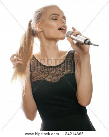 young pretty blond woman singing in microphone isolated close up black dress, karaoke girl little show star
