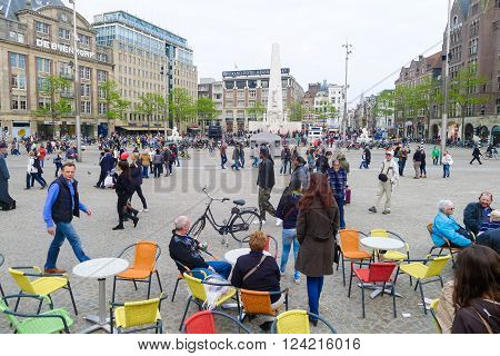 Amsterdam, The Netherlands May 30 2013: Many tourists and locals gather in Dam Square in Amsterdam city.