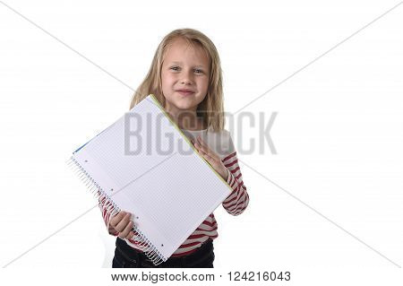 sweet beautiful female child 6 to 8 years old with cute blonde hair and blue eyes holding notebook or notepad isolated on white in education and primary or junior school supplies concept