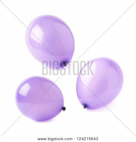 Inflated violet air balloons isolated over the white background, set collection of three different foreshortenings