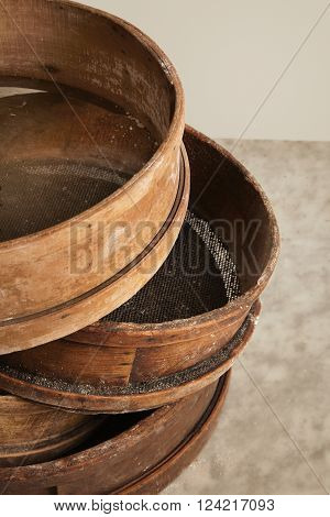 Old Vintage Wooden Kitchen Sieve Isolated On White Stone Marble Table In Artisan Professional Bakery