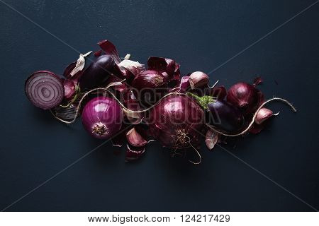 Red Onions And Cut Halves, Peeled And Not, With Small Baby Eggplants And Garlic Isolated On Rustic V