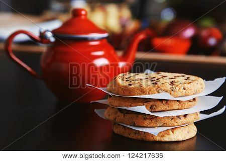Morning Set. Tasty Crunchy Homemade Cookies On Black Table In Front Of Unfocused Red Vintage Teapot