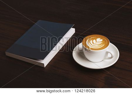 Side View Perfect Cappuccino With Tree Milky Foam Art On Top Near Business Note Book Isolated On Red
