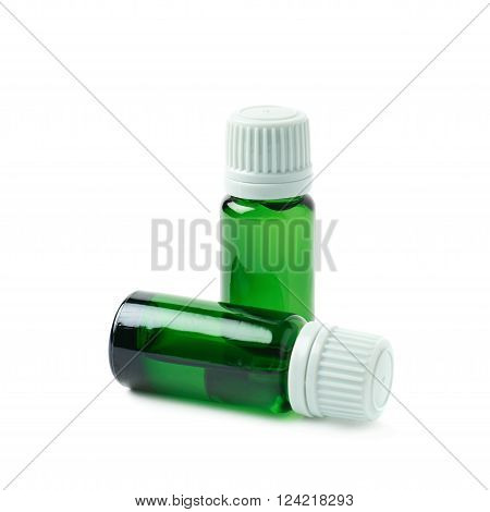 Small green glass flask vial, composition isolated over the white background