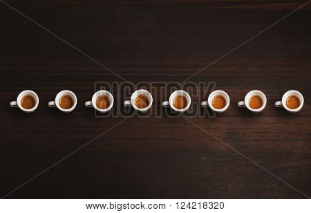 Set Of Small Ceramic Cups With Espresso Or Ristretto, Freshly Brewed In Artisan Cafe, Isolated In Ro