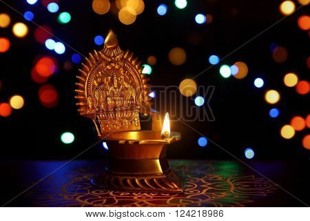 Indian Traditional kamatshi amman oil lamp and light ** Note: Shallow depth of field