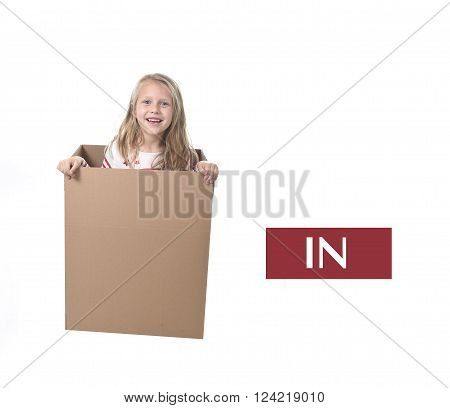 cute and sweet blond hair child in cardboard box isolated on white background in learning english prepositions and words language card set for education school textbook