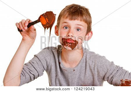 Baking Time With A Young Boy Eating The Chocolate