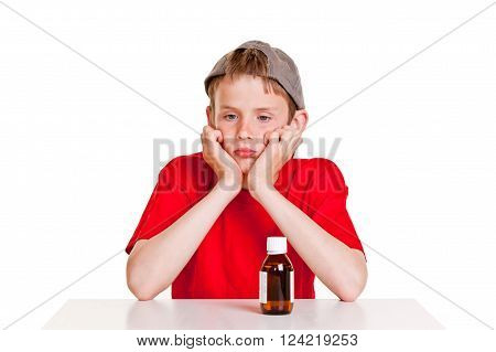 Pouting Boy With Medication Bottle