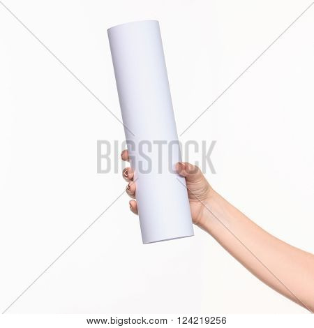The white cylinder of the props in the female hands on white background with  right shadow