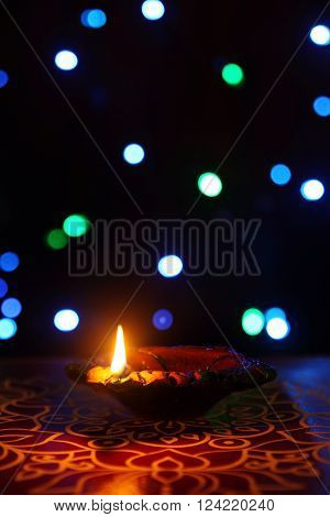Indian Traditional kolam with Oil Lamp and Light