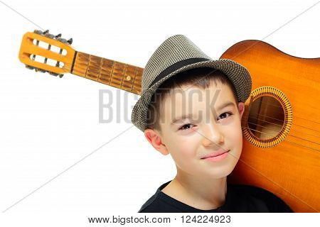 Portrait of eleven years old boy with guitar on white background