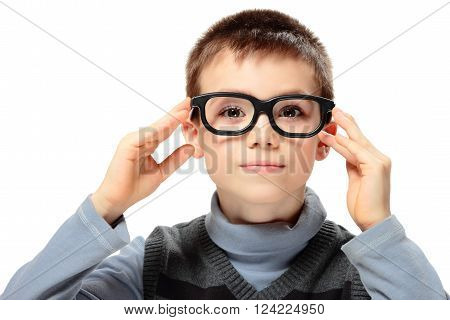 Young boy with glasses isolated on white background
