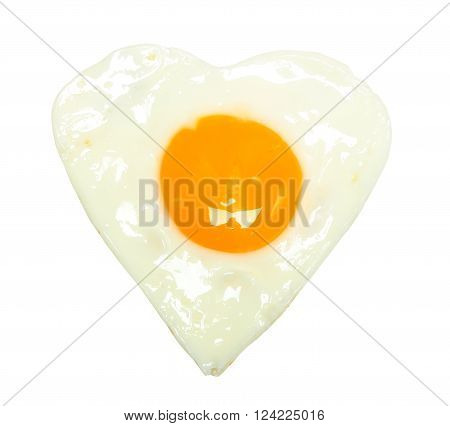 Fried egg in shape of heart isolated on white background
