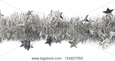 Line of a silver tinsel decorational Christmas garland isolated over the white background