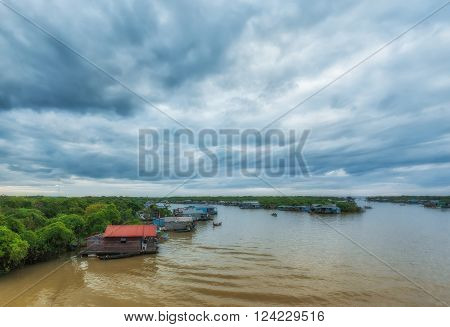 Cambodian people live on Tonle Sap Lake in Siem Reap, Cambodia.   This is the largest freshwater lake in SE Asia peaking. Annual flooding of the village.