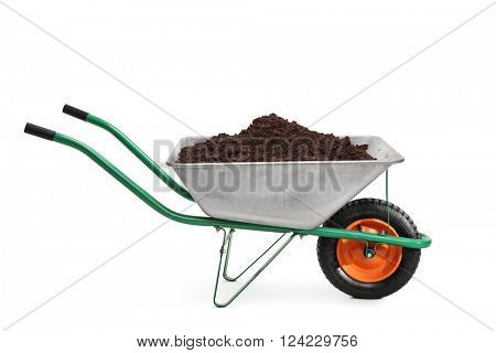 Studio shot of a wheelbarrow full of dirt isolated on white background