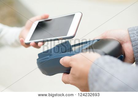 Woman using cellphone for payment
