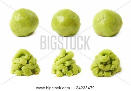 Wasabi paste as a pile or a ball, each in three foreshortenings, isolated over the white background