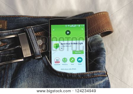 SARANSK, RUSSIA - April 3, 2016: Photo of Smartphone in a jeans pocket with Dr.Web application in a Google Play Store on the screen.