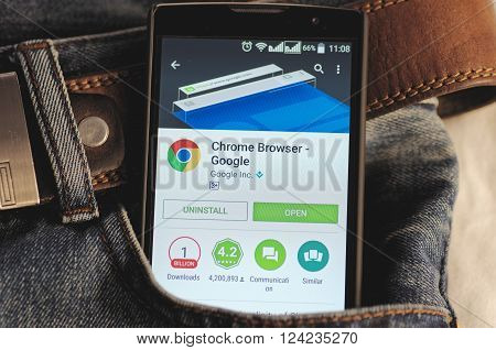 SARANSK, RUSSIA - April 3, 2016: Photo of Smartphone in a jeans pocket with Google Chrome application in a Google Play Store on the screen.