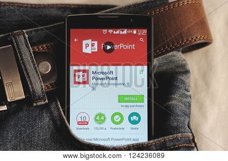 SARANSK, RUSSIA - April 3, 2016: Photo of Smartphone in a jeans pocket with Microsoft PowerPoint application in a Google Play Store on the screen.