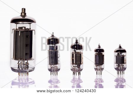 Vacuum tube set in a number of frontally on a white background