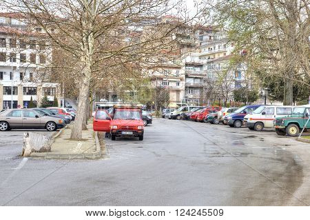 KASTORIA GREECE - March 12.2016: Area with a motor-car stand in city Kastoria