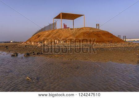 an empty watch tower overlooking the beach resort
