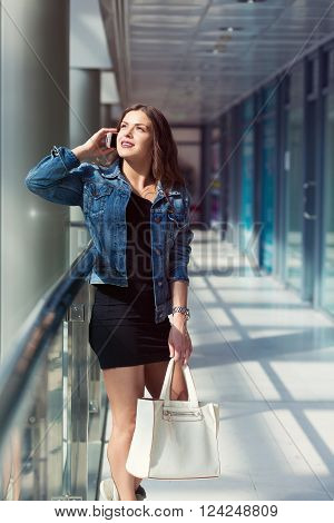 Pretty young woman shopping in the mall