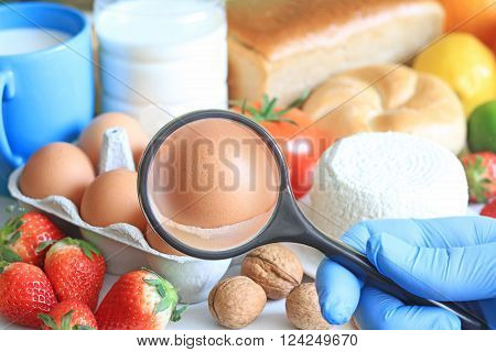 Allergy food abstract concept with examining doctor and magnifier