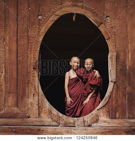 Nyaung Shwe, Myanmar - March 24, 2014: Novice Buddhist monks smiling at Shwe Yan Pyay Monastery in Nyaung Shwe village near Inle Lake, Shan State, Myanmar (Burma).