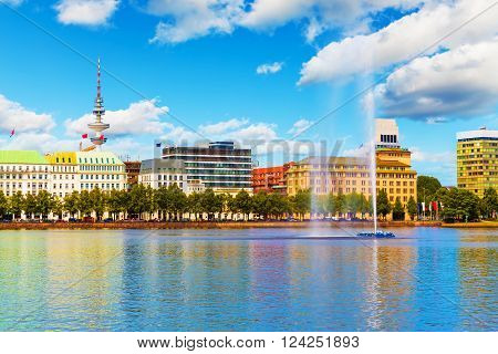 Scenic summer view of the Old Town architecture and pier of Alster lake and river in Hamburg, Germany