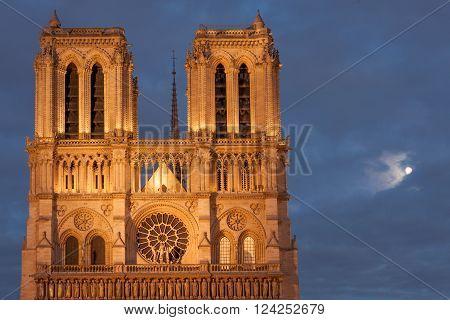 Full moon by Notre Dame de Paris facade, Paris