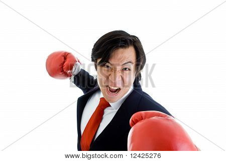 Angry Asian Business Man Boxing Gloves Punching Threatening Camera, Isolated