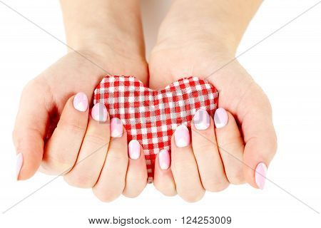 Female Hand With Manicure Holding Heart On A White Background