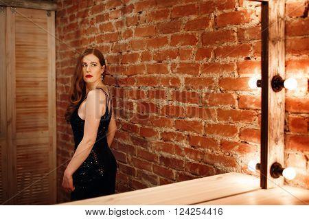 Seductive Woman Looking At Mirror