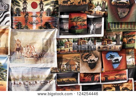 DURBAN SOUTH AFRICA : APRIL 1 2016: Closeup display of painted canvases on display on sidewalk stall on beach front in Durban South Africa