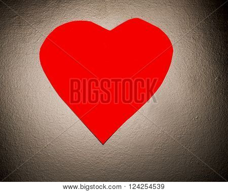 Red heart on a dark surface symbolizing romance or healthy